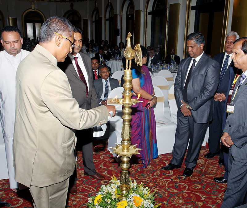 Lighting the oil lamp to start the ceremony