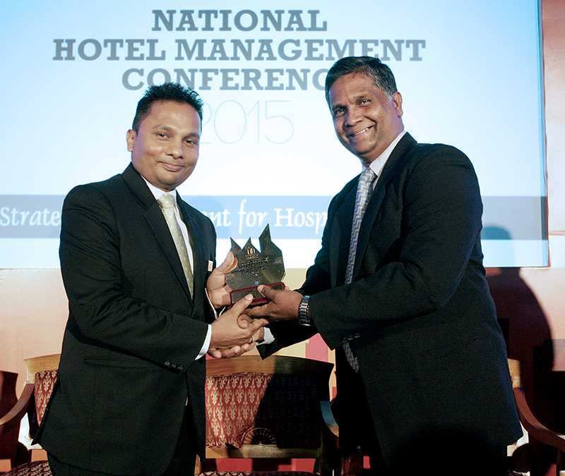 Presenting an award at the National Hotel Management Conference 2015
