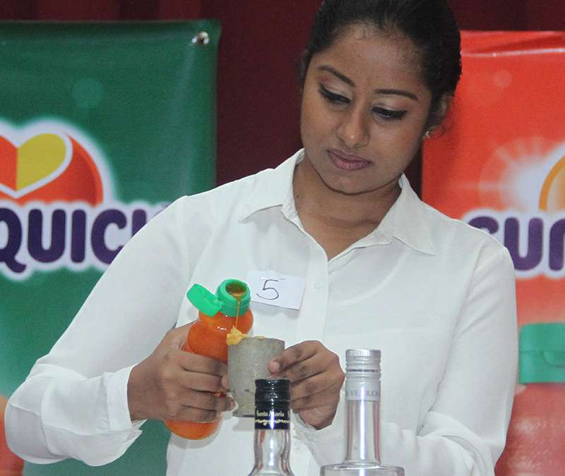 A contestant preparing Sunquick cocktails