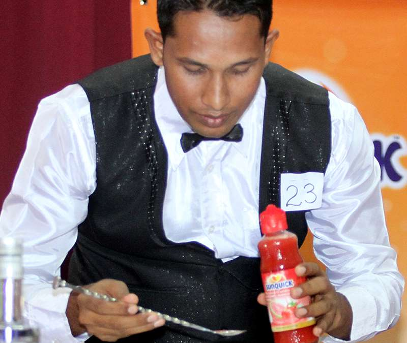 A contestant preparing cocktails with Sunquick