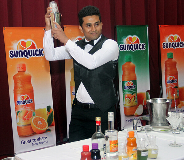 Mixing sunquick cocktails at the National Bartenders Competition